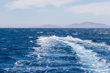foam sea trace of the cruiser boat travel in deep blue ocean water splash 스톡 콘텐츠