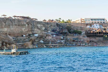 Island, white sandy beach red sea Egypt. Chair and umbrella honeymoon vacation panorama Stock fotó