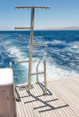 Ships Ladder water splash foam sea trace of the cruiser boat travel in deep blue ocean 스톡 콘텐츠