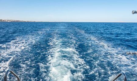 foam sea trace of the cruiser boat travel in deep blue water splash