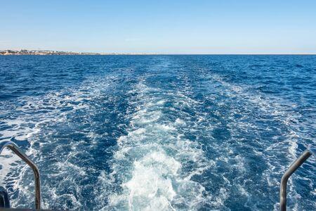 foam sea water splash trace of the cruiser boat travel in deep blue ocean 스톡 콘텐츠