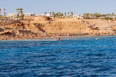 Island, white sandy beach red sea Egypt. Chair and umbrella honeymoon vacation panorama Stock Photo