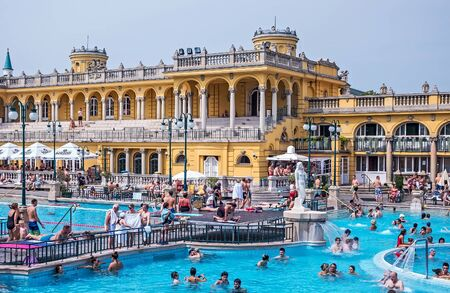 Szechenyi Thermal spa outdoor bath people public In Budapest. Szechenyi Medicinal Bath is the largest medicinal house with so many pools in Europe, Hungary. August 24, 2019
