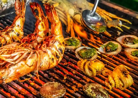 Prawn or tiger shrimp Cooking Barbecue Fire Grill Close-up Black Food Background
