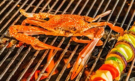 Barbecue steamed cooking grill Food Background Crab. Cooking Barbecue Fire Grill Close-up blue crabs.