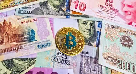 Gold Bitcoin Close up Collection of banknotes. Blockchain technology luxury backround Crypto currency money exchange for trade. Physical Coin Cryptocurrency BTC money Crypto Investing.