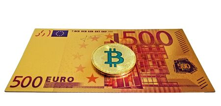 BTC Gold Plated Bitcoin Coin currency. Gold Bitcoin cryptocurrency 500 euro banknotes isolated on white background.