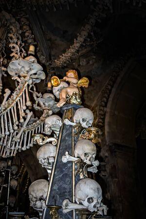Abstract Part of interior decorated wall hell with real human skeleton bones church. Soft focus