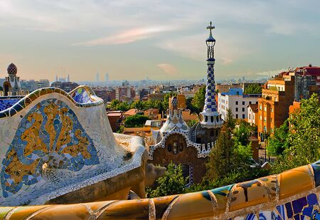 Designed by Antoni Gaudi Famous house decoration in Park Guell Mosaic Tiles Architectural Barcelona. Catalonia, Spain