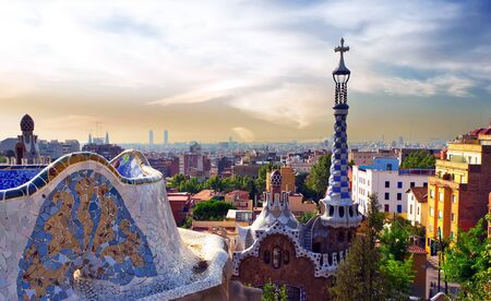 Designed Famous house by Antoni Gaudi decoration in Park Guell terrace Mosaic Tiles Barcelona. Catalonia, Spain