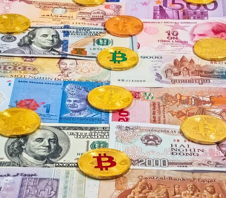 Gold Bitcoin Close up Collection of banknotes cryptocurrency exchange. Blockchain technology Virtual digital currency.