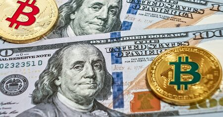 Gold bitcoin coin one hundred U.S. dollars bills background cryptocurrency mining concept. Macro portrait of Benjamin Franklin