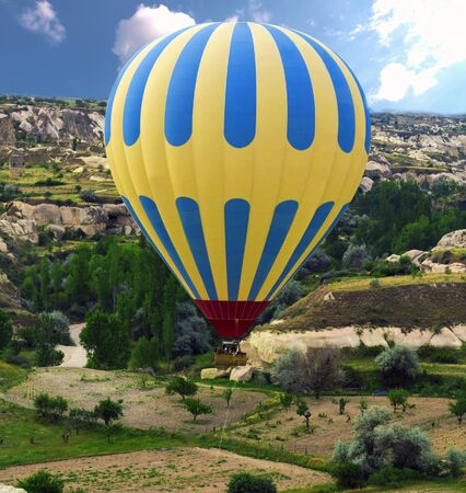 Goreme Historical National Park hot air balloons flying over Cappadocia, Goreme, Turkey Reklamní fotografie