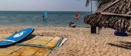 PHAN THIET, VIETNAM - Feb 16, 2015: Girl pretty, People tropical beach with coconut palm trees, Phan Thiet. Sunbed woman tanned body bikini sunbathing on deck chair, relaxing on beach chair. Standard-Bild - 134696835