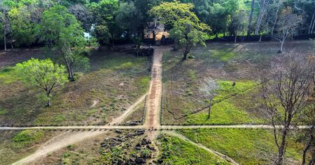 Top view landscape Dirt Road Forest path Prasat Thom ancient Pyramid Lost City in jungle trees and ruins Angkor Wat Preah Vihear Cambodia. Archaeological Landscape nature way of Koh Ker, Cambodia. Stock Photo