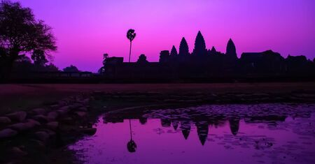 Panorama Mist sunrise tropical morning violet lake holy Angkor Wat facade silhouette khmer culture Siem Reap Cambodia