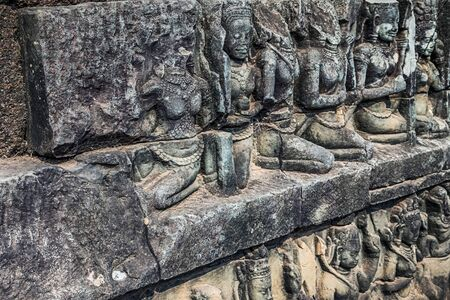 many ancient bas-reliefs god at Angkor Wat temple, Siem Reap, Cambodia. Stock Photo
