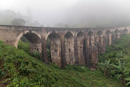 Beautiful panoramic Mountain mist Nine Arch Bridge Railway Viaduct in Ceylon, Demodara - Tourist attractions in Badulla District, Sri Lanka.