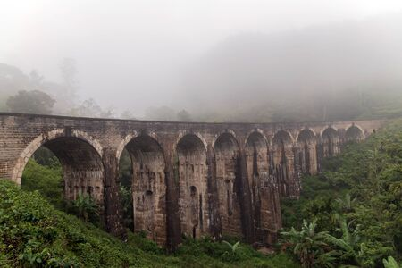 Nine Arch Bridge rainforest morning fog Demodara Sri Lanka Railway Viaduct