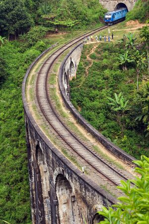Nine Arch Bridge Railway Viaduct in Ceylon, Demodara - Train crossing Tourist attractions in Badulla District, Sri Lanka. Stock Photo