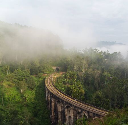 Nine Arch Bridge in Demodara mist rain forest - Sri Lanka is a famous landmark. Sri Lanka Railway Viaduct stone. Stock Photo