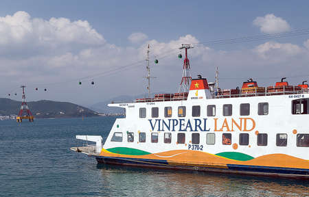 NHA TRANG, VIETNAM - FEB 12, 2015: Sea ferry and cable car eiffel tower to Vin pearl land Island to the Vinpearl Amusement Park, Nha Trang, Vietnam.