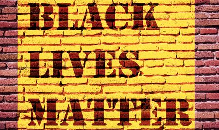 Black Lives Matter slogan protestors anti Black racism african American yellow stencil pattern brick wall texture background