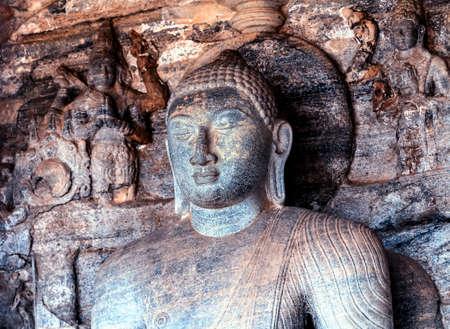 Buddha statue stone rock carving Vidyhadhara Guha at Gal Vihara in Polonnaruwa ancient city of Sri Lanka.