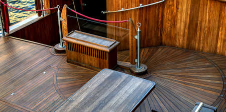 Old sailship wood deck cruise ship balcony.