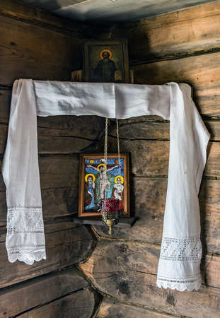 Ancient Orthodox icon painting christian old religious Red Corner. Icon Corner is the home altar. Verkhniye Mandrogi, RUSSIA - JUNE 15, 2015