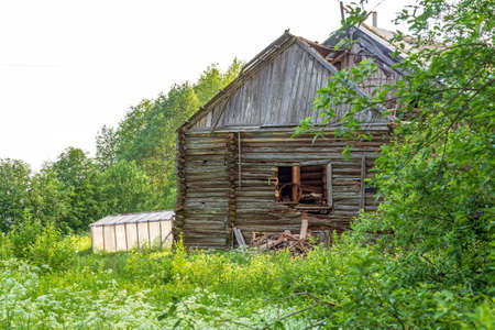 Abandoned wooden house destroyed weathered