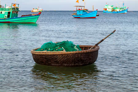 Fishing net catching fish in Old Fishermen's bamboo basket boat vietnamese