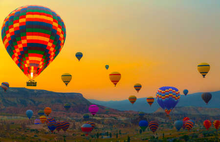 Hot air balloons landscape at sunrise panoramic view of nice colorful mountain. Cappadocia morning trip Goreme Park, Turkey.