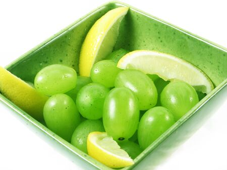 grapes fruit in green bowl on white background photo