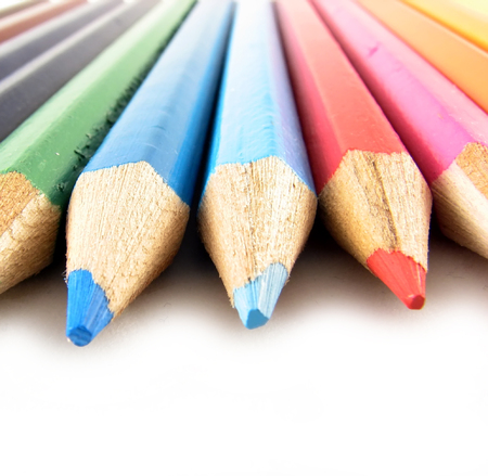 school and office articles: coloured pencils on white background