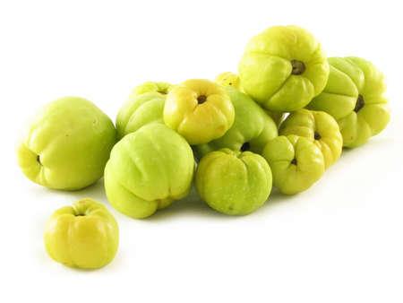 nature compoisition on white: fruits of quinces  Фото со стока
