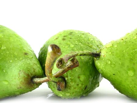 composition on white: wet green pears