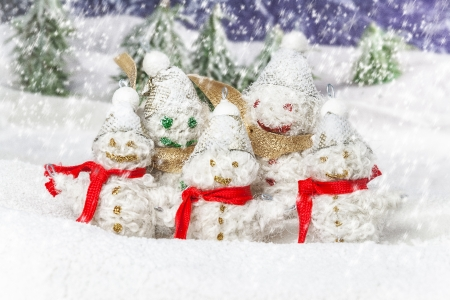 happy and smiling snowmen in the winter scenery photo