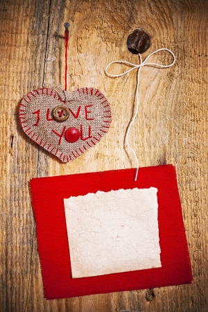 Decoration on Wooden background with fabric Heart and blank card photo