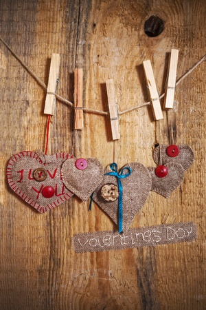 Decoration on Wooden background with fabric Hearts and words Valentines Day
