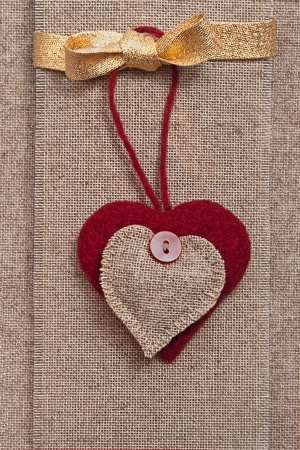 Art retro background with fabric Hearts for greeting card or design photo