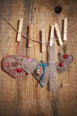 Decoration on Wooden background with fabric Hearts and words Valentines Day photo
