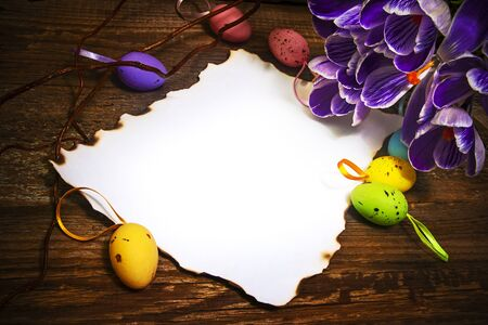 Art Easter decoration with blank card, eggs  and crocus photo