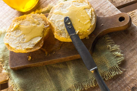 Roll and sweet honey on wooden background