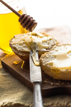 eat smeared: Roll and sweet honey on wooden background