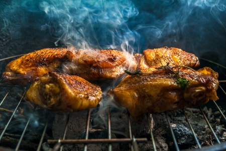 Baked Chicken legs on the grill photo