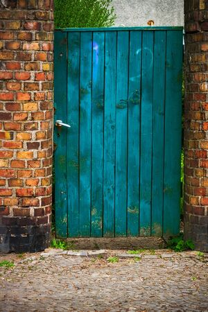 wicket gate: Old door wicket gate in a brick wall Stock Photo