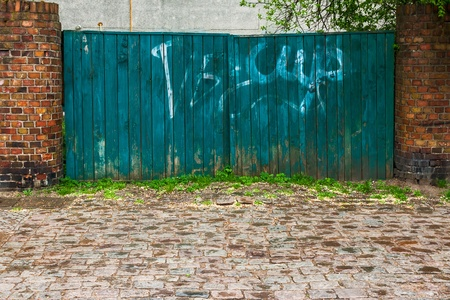 wicket: Old door wicket gate in a brick wall Stock Photo