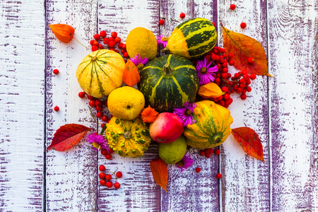 Autumn setting on the wooden table with fruits and vegetables photo