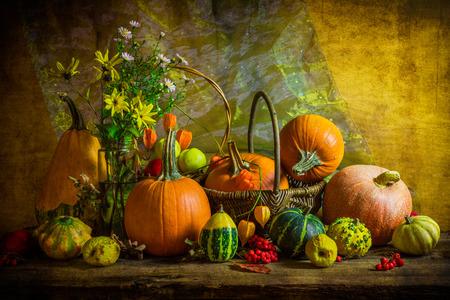 Autumnal Halloween still life with pumpkins, rowan and quinces photo